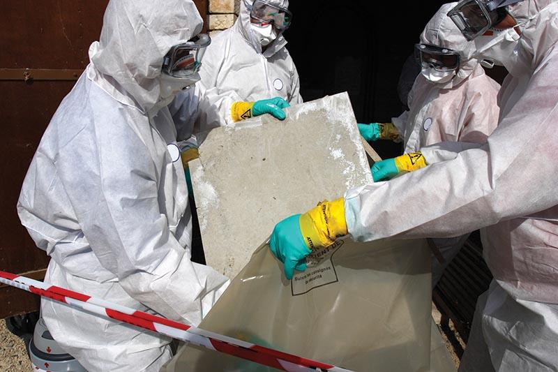 Staff removing some asbestos